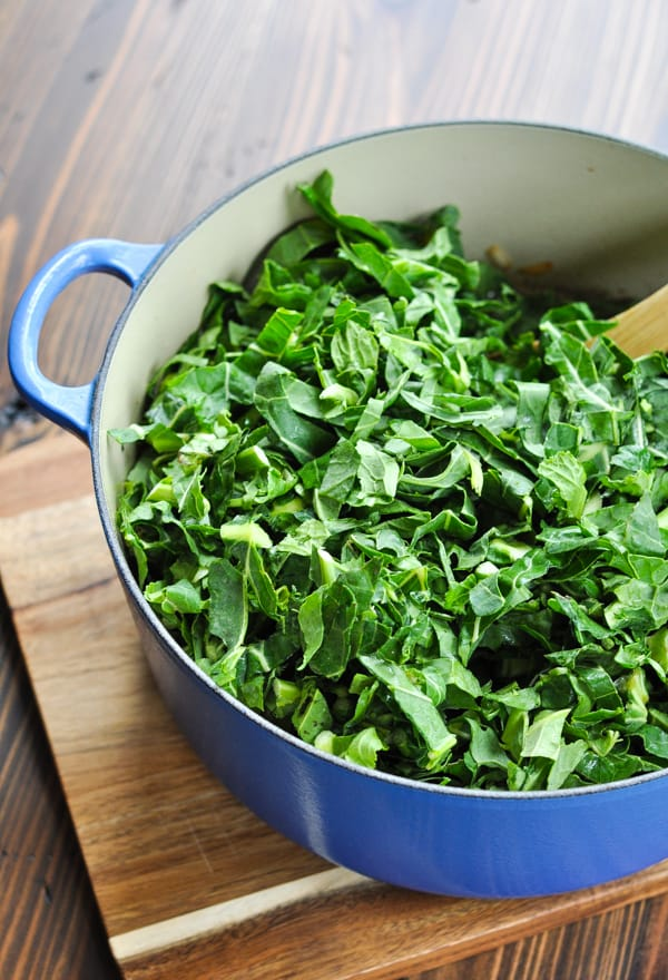 Fresh collard greens in blue Dutch oven