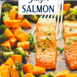 Close up front shot of maple glazed salmon on a sheet pan with text title overlay