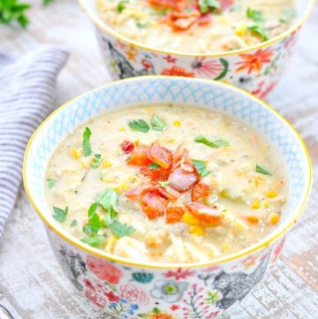 Close up shot of bowl of Slow Cooker Corn Chowder with Chicken and crumbled bacon on top