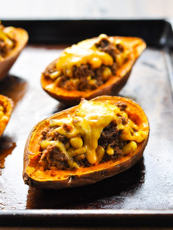 Taco stuffed potatoes with melted cheese on top