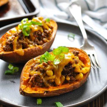 Taco stuffed potatoes on a gray plate