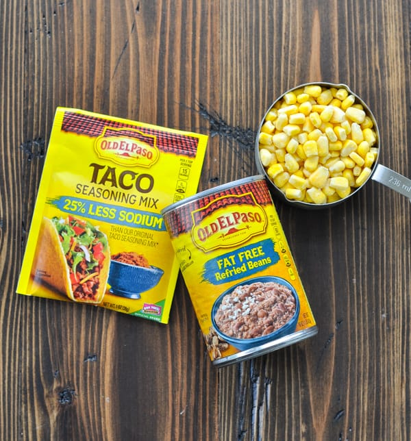 Taco seasoning refried beans and corn for stuffed potatoes filling