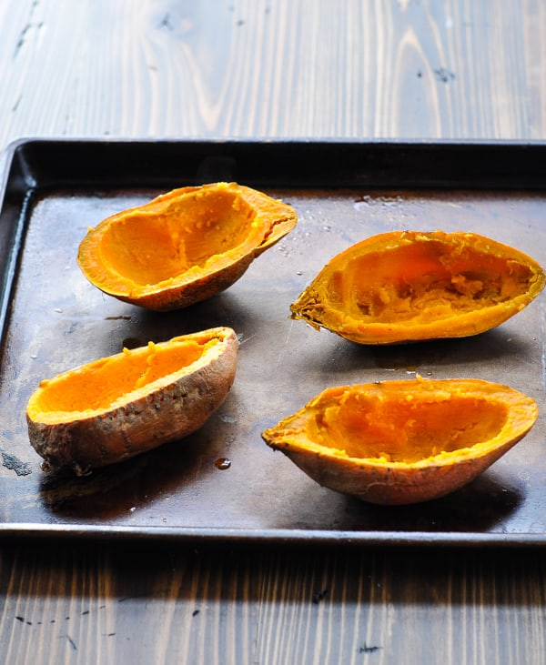 Hollowed out sweet potato skins on a baking sheet