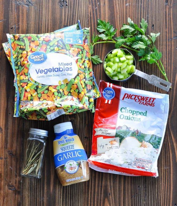 Vegetables and herbs for baked garlic chicken