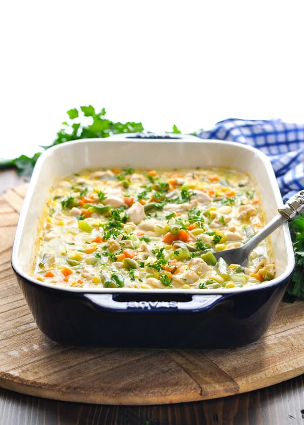 Baked chicken and vegetables in a garlic cream sauce garnished with parsley