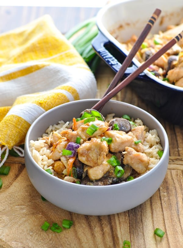 Moo shu chicken in a bowl with rice and chopsticks
