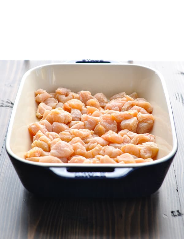 Diced raw chicken breast in baking dish