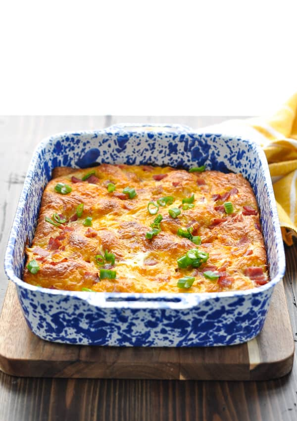 Baked ham and cheese egg casserole with green onions on top