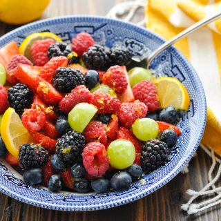 Front shot of half of a bowl of fresh fruit salad close up