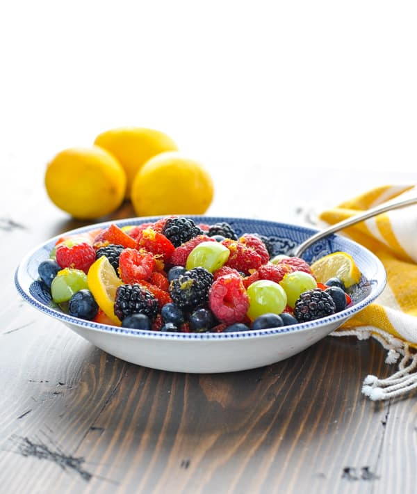 Bowl of fruit salad with a serving spoon in the dish