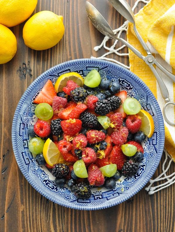 Overhead shot of blue and white bowl full of fresh fruit salad recipe