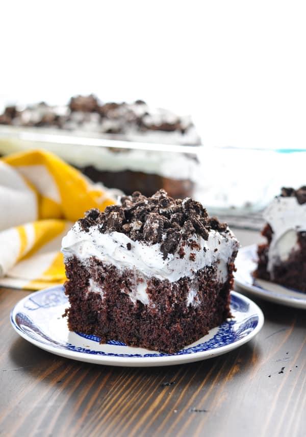 Oreo Poke Cake with pockets of vanilla pudding inside