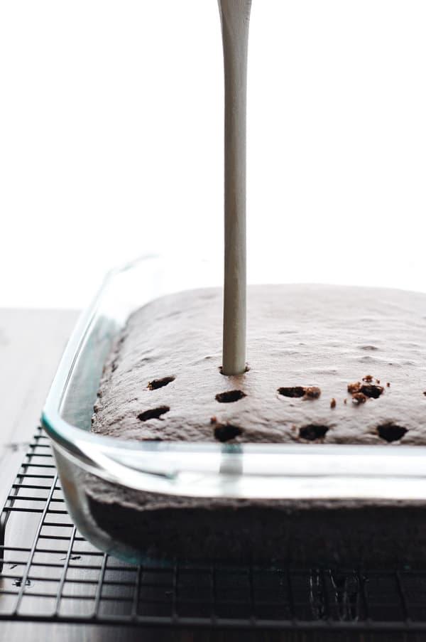 Poking holes in chocolate cake