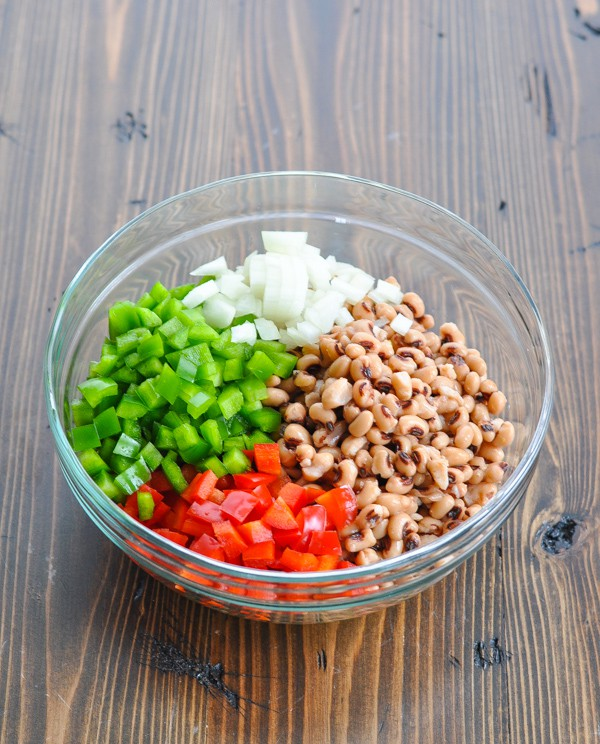 Texas caviar ingredients in a large glass mixing bowl