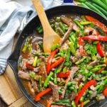 Overhead shot of half skillet of Asparagus and Beef Stir Fry