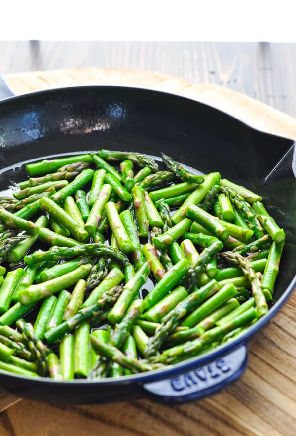 Chopped fresh asparagus in cast iron skillet