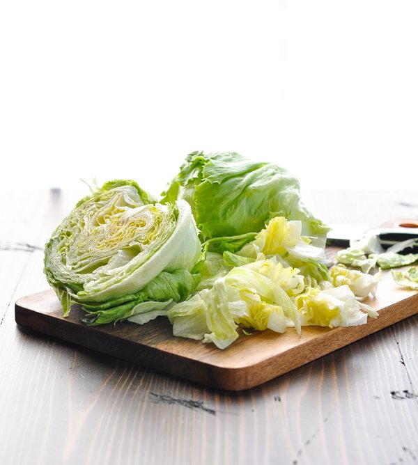 Chopped iceberg lettuce on a cutting board