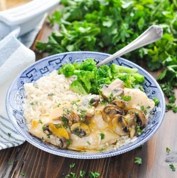 Chicken marsala in a bowl with rice and broccoli