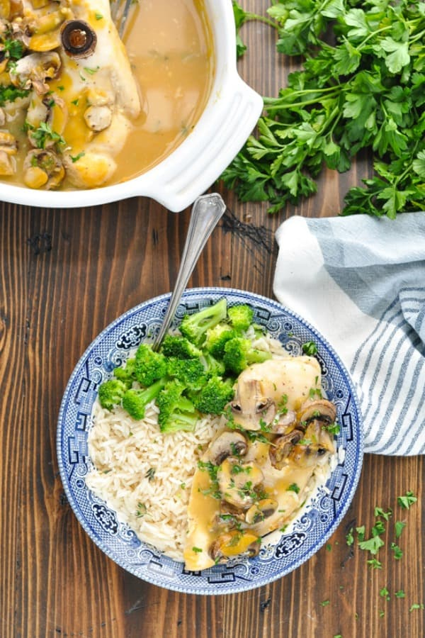 Long overhead shot of healthy baked chicken marsala recipe in a bowl and in a baking dish