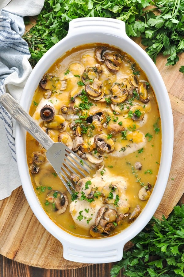 Long overhead shot of baked chicken marsala recipe in a white casserole dish