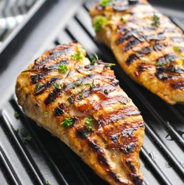 Close up shot of marinated chicken on a grill pan