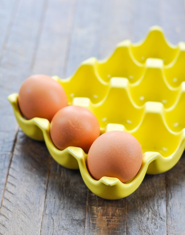 3 eggs in yellow egg dish