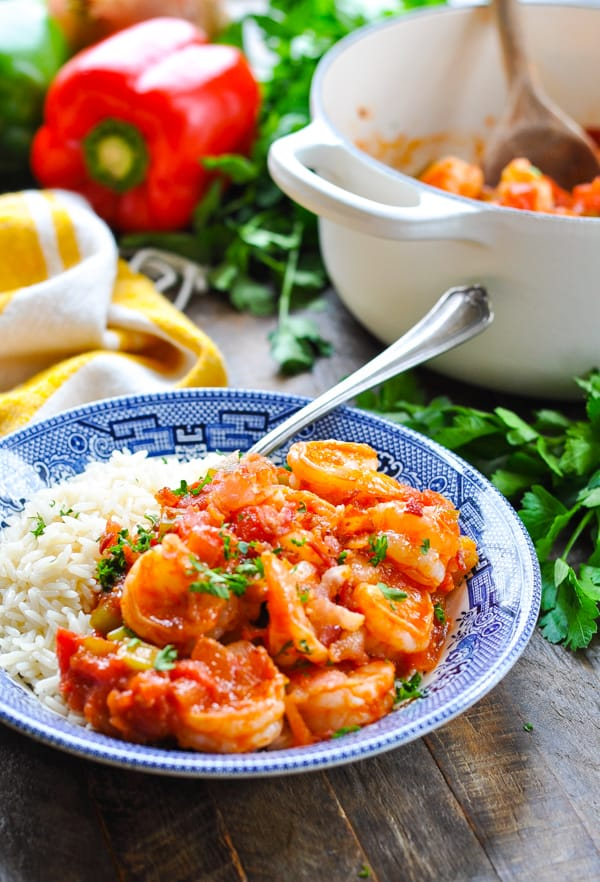 Front shot of shrimp creole with white rice in a bowl