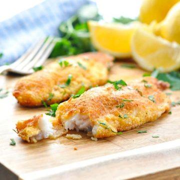 Fried catfish on a cutting board
