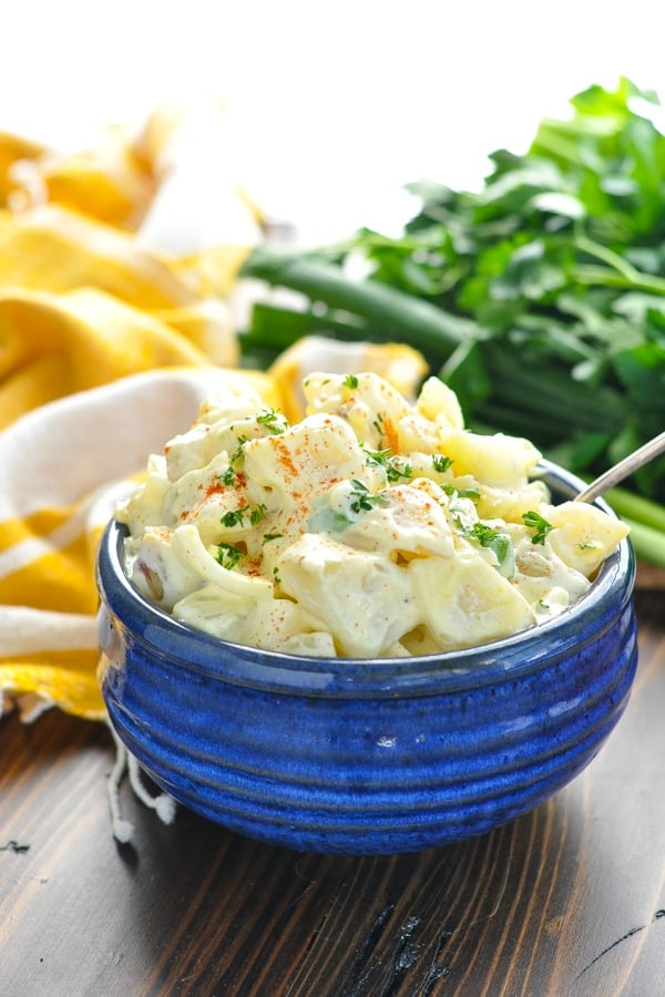 Front shot of southern potato salad in a blue serving bowl