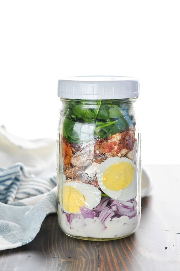 Spinach and Bacon and Egg salad in a jar