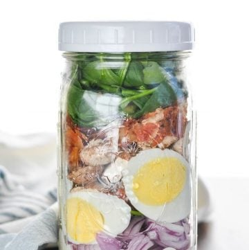 Spinach Salad with bacon in a mason jar