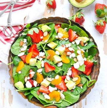 Overhead shot of rustic bowl of strawberry spinach salad