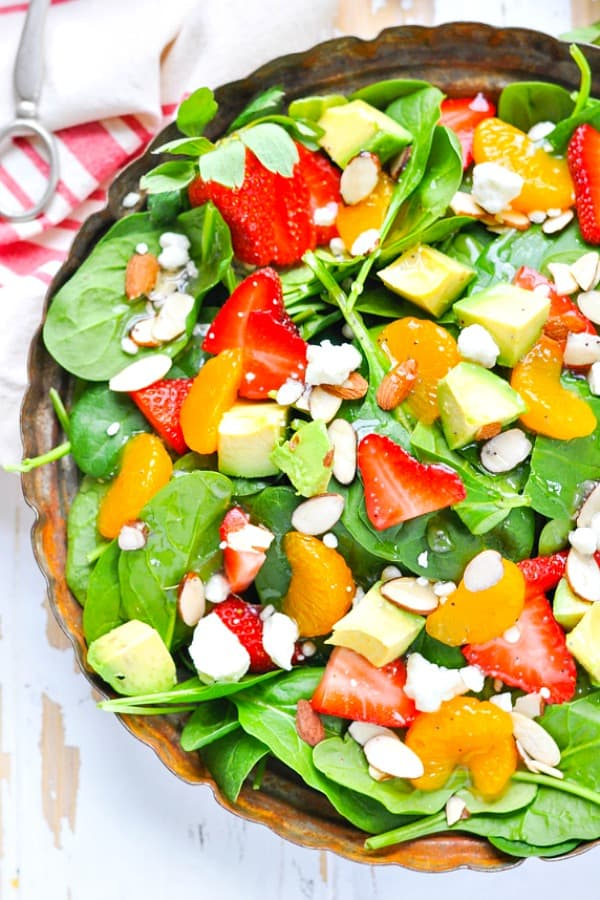 Close up overhead shot of strawberry and spinach salad in a bowl