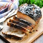 Sliced grilled pork loin on a cutting board