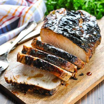 Sliced grilled pork loin on a cutting board
