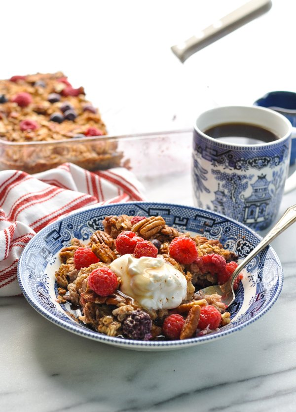 Front shot of blueberry healthy oatmeal bake in a bowl with fresh berries on top