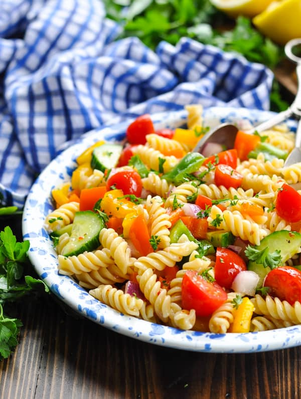Close up shot of classic pasta salad with fresh vegetables