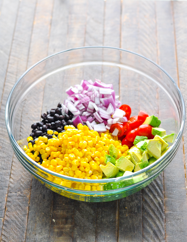 Ingredients for Black Bean and Corn Salad in a glass mixing bowl
