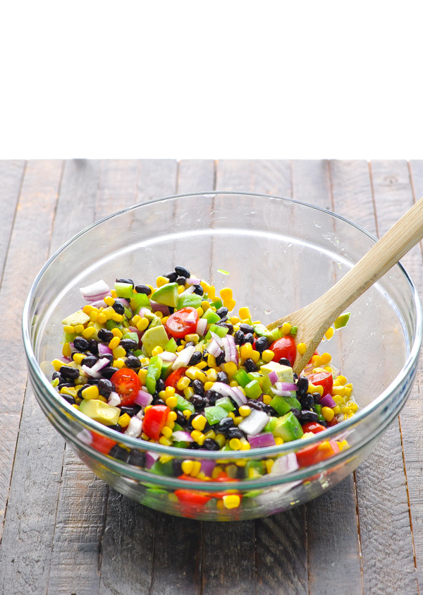 Corn and black bean salsa in a glass mixing bowl