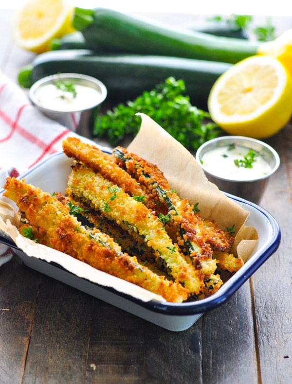 Close up shot of golden crispy baked zucchini fries