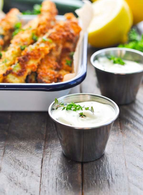Front shot of small bowls of creamy zucchini fries dip