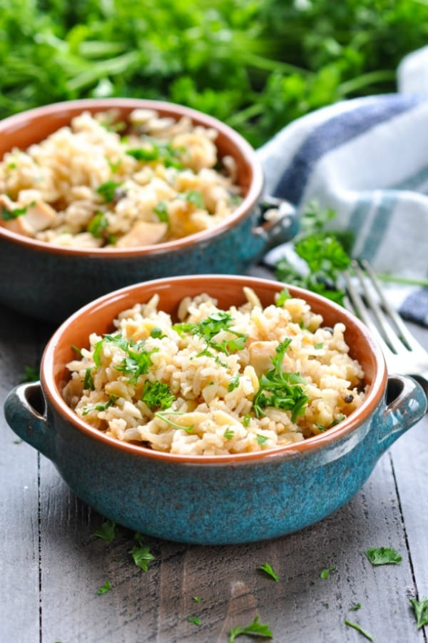 Chicken and rice pilaf in two turquoise bowls