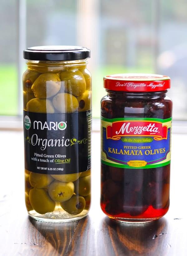 Two jars of green and kalamata olives