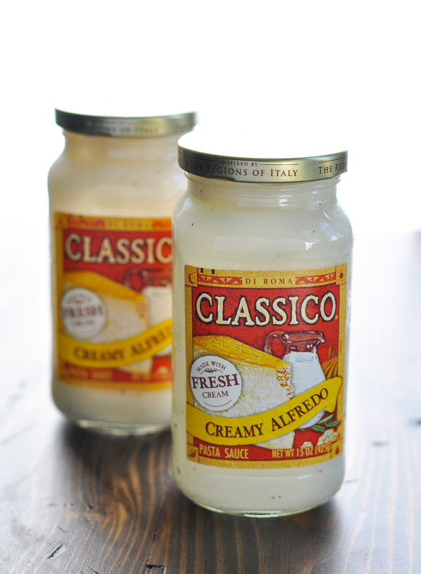 Two jars of alfredo sauce