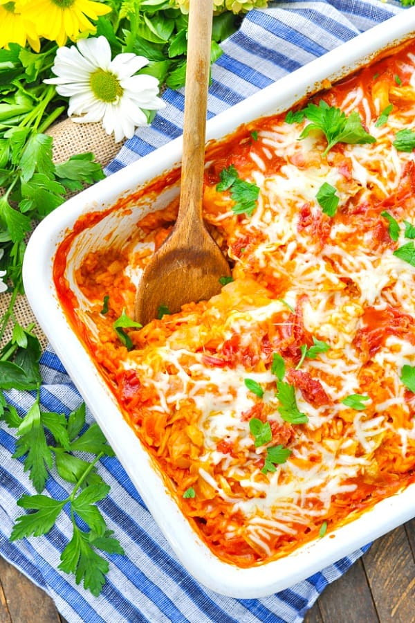 An overhead shot of a stuffed cabbage casserole in a white dish
