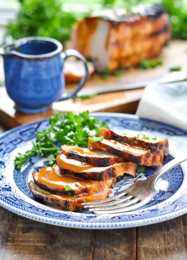 Sliced grilled pork on a plate