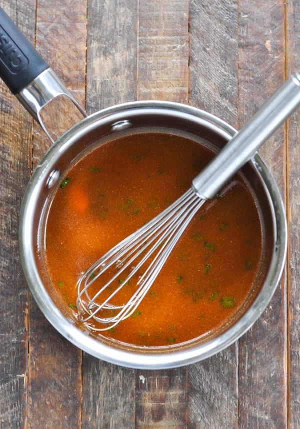Pork tenderloin marinade in saucepan with whisk