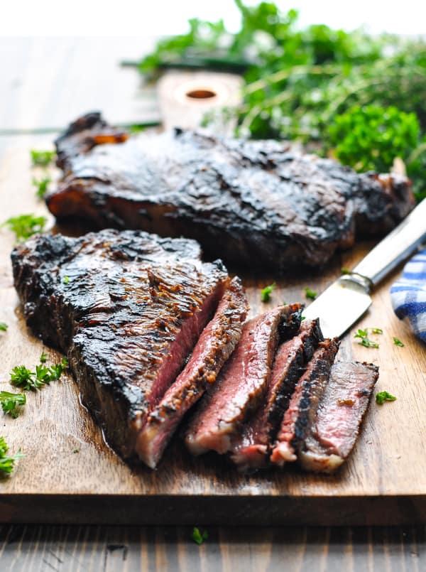 Close up front shot of sliced marinated new york strip steak