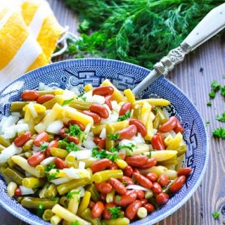 Classic three bean salad in a blue and white serving bowl