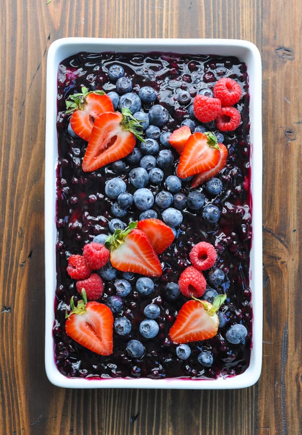 Icebox cake with strawberries and blueberries on top